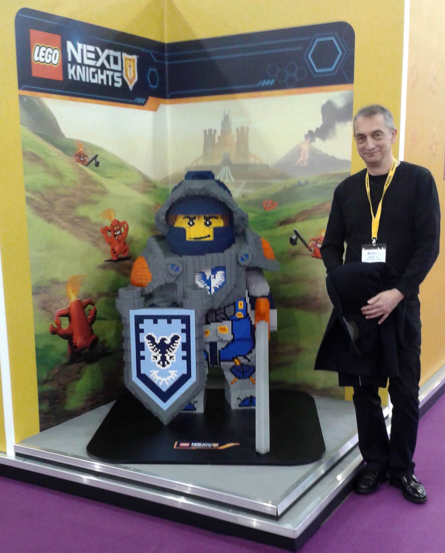 Adie Hardy standing next to a Lego display at The Toy Fair 2016 image