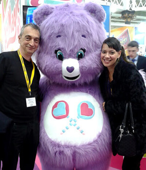 Adie Hardy and Anna-Christina cuddling with Share Bear the Care Bear at The Toy Fair 2016 at Kensington Olympia image