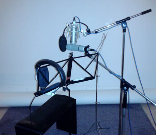 The narrator's chair set up with microphones at Unit 2 Studios, London