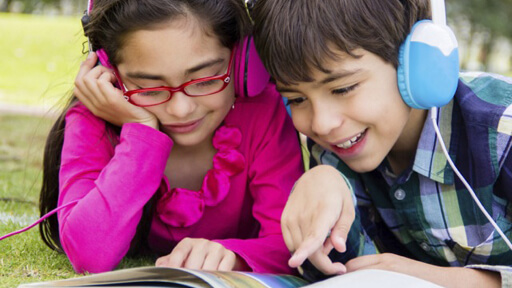 Children listening to audiobooks image